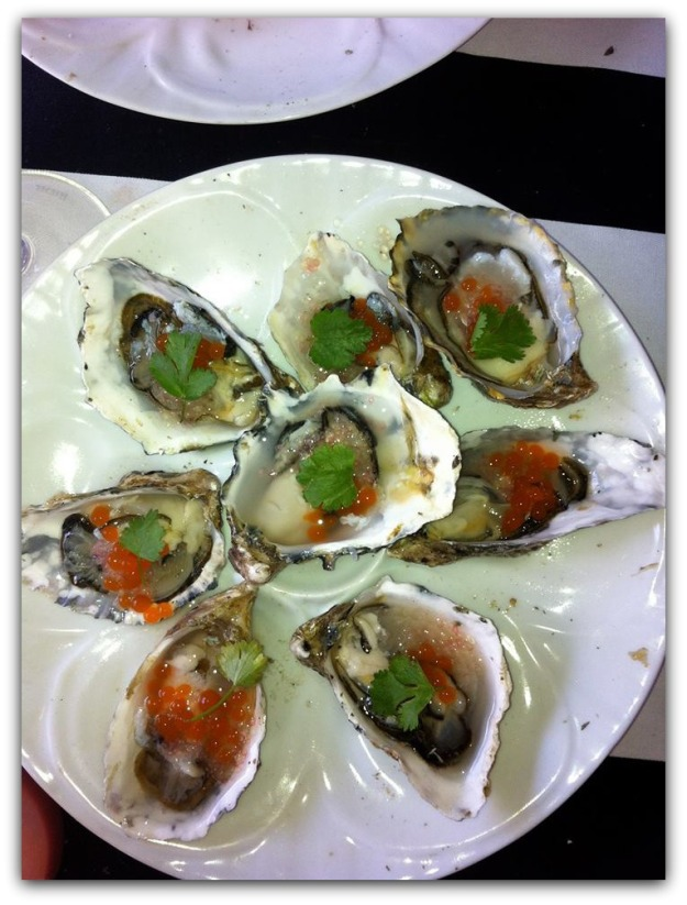 Oysters Served by Ethan and Tobias at FEAST Portland, a Northwest Culinary Event. Porcelain Oyster Plater Made by HIC.